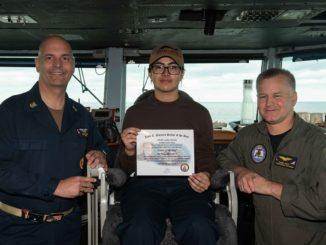 U.S. Sailors pose for photo